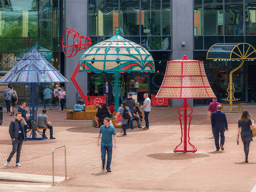 People interacting with supersized lamps in Manchester Square